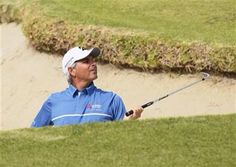 (AP Photo/Danny Moloshok). Fred Couples peers out of a bunker after hitting onto the first green during the second round of the Northern Trust Open golf tournament at Riviera Country Club in the Pacific Palisades area of Los Angeles on Friday, Feb. 20, 2015.