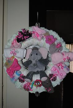 Baby Girl Diaper Wreath w/ Baby Scentsy Buddy..  What a sweet idea!!  http://heathersimmons.scentsy.us/