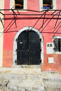 Mostar, salmon-colored house door