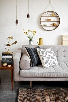 While I generally prefer colorful rooms, this mix of subtle gray and white is restful.  The ochre jug saves it from blandness.