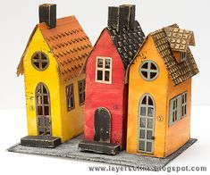 Layers of ink - Old Town Houses Tutorial by Anna-Karin. These houses were inspired by the Old Town (Gamla Stan) of Stockholm and made with Sizzix dies by Tim Holtz and Ranger ink and paints.