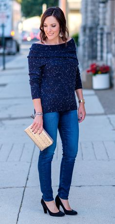 Jo-Lynne Shane wearing a casual fall off-the-shoulder sweater outfit with a navyflecked off-the-shoulder sweater, AG Farrah skinny jeans, and black suede pumps. #falloutfit #offtheshouldertrend