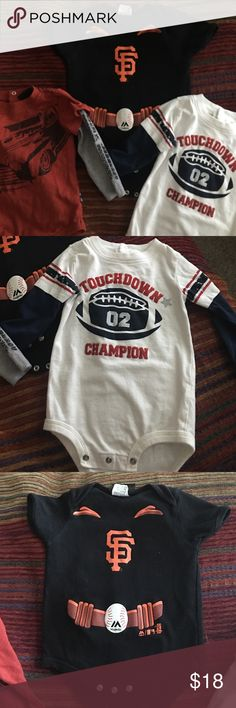 Lot of 3 - Boy Onesie Tops - Size 12 mos. All gently used, and need a new home!  All size 12 mos.  All 3 are onesies and snap at the bottom.  First is a white top with navy blue long sleeves with football graphic on front. The second is a Giants jersey that is black and orange with short sleeves.  The last is a muted red top with long grey sleeves and a race car graphic on front.  No holes, spots, etc.  In great condition. several Shirts & Tops Tees - Long Sleeve