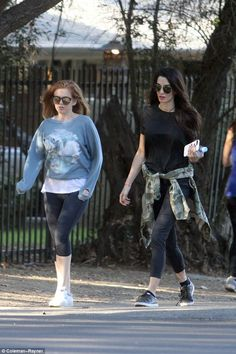 Amal's life in Hollywood! Mrs Clooney enjoys a hike with actress pal Isla Fisher as the two catch up in LA on Friday