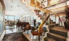 Retro: The geometric shapes and gold lining of the floating staircase is reminiscent of 19...