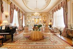 Opulent: The drawing room in Joan Rivers' Upper East Side condo is a sea of pink and gold velvet, with a grand piano in the corner, lit by three glittering chandeliers