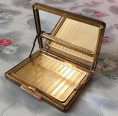 Vintage Stratton compact mirror wiper compact self cleaning mirror 1950's powder compact in hand goldtone self opening inner lid miraclean by DaynartVintage on Etsy
