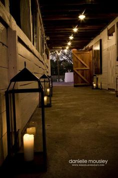 Lanterns With Candles Glow Throughout The Barn To Create A Charming Atmosphere Rustic
