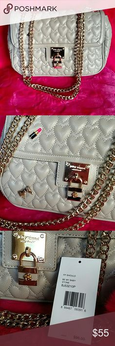 Betsey Johnson crossbody flap bag Only used once. Perfect condition never with the tags unattached. It's a faux pebbled leather with gold hardware and gold chain strap. Very cute and spacious inside. Zips up and flap magnetic closure. Color on tag says stone it's a mauvey beige color Betsey Johnson Bags Crossbody Bags