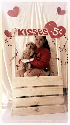 Kissing booth for a valentine's day adoption event for cats and dogs