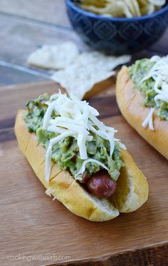 California Dogs - all beef hot dogs wrapped in bacon and topped with guacamole and Monterey Jack cheese | cookingwithcurls.com