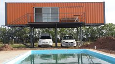container home on stilts with stairs