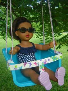 Transform a stackable bin into a doll swing.