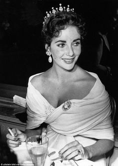 Hollywood royalty: Elizabeth Taylor attended the 1957 Cannes Film Festival with her third husband, theater and film producer Mike Todd, wearing an off-the-shoulder ruched dress and a diamond tiara