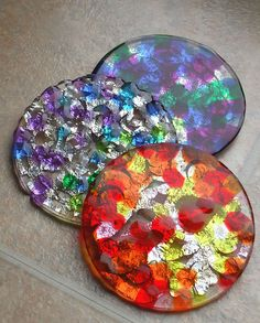 Melted bead suncatchers by angry_gato (flickr) - these have a patterned foil backing that adds some nice sparkle. =)
