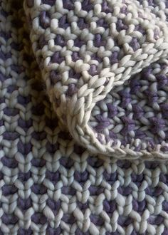 Ravelry: Beautyberry Blanket -- free pattern by Purl Soho -- here giving great texture in a super-bulky wool. Notice how the two sides have quite different appearances. #knitting