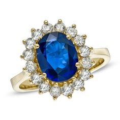 Oval Blue Sapphire and 5/8 CT. T.W. Diamond Frame Engagement Ring in 14K Gold