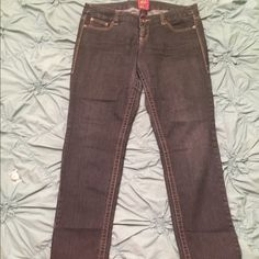 Torrid dark wash straight leg jeans Size 16 (long) Size 16 (long) Torrid straight leg jeans. Great fit and quality denim. They have a bit of stretch, but are sturdier than jeggings. These are so slimming. Lost a bit of weight so they just don't fit as well as they used to. Small flaw on stitching on back pocket (pictured). Gently used or perfectly broken in, depending on how you look at it! :) torrid Jeans Straight Leg