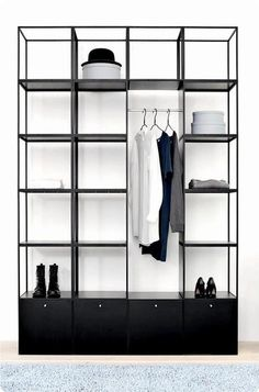 I love this! I think I'd like it in white or a light wood grain even better.   #grid #freestanding #closet #black