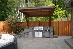 stamped patio with grilling area | ideas for Fair Patio Traditional design ideas with covered grill grill ...