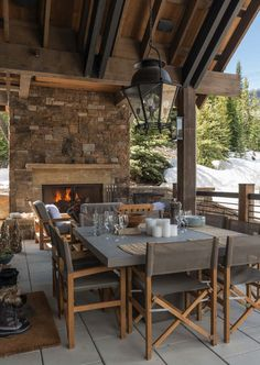 You can find this modern chalet design in the USA. The chalet is located near the ski resort. So, there's a sauna, heated pool, and outdoor terrace. Chalet Design, Chalet Style, Ski Chalet, Outdoor Rooms, Outdoor Dining, Roof Design, House Design, Covered Patio Design, Concrete Dining Table