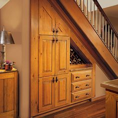 Built in storage for under stairs plus mini wine storage feature. Staircase Storage, Stair Storage, Built In Storage, Extra Storage, Wall Storage, Under Steps Storage, Staircase Ideas, Book Storage, Wine Storage Cabinets