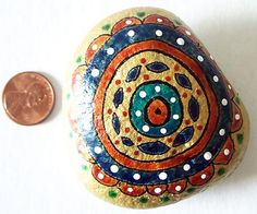 Brand new painted stone, now available in my store...check it out..Flower, www.karlagerard.com