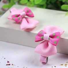 A pair of boutique hairclips in pink grosgrain bows with dotted bow on top. Material: Cross Grain Ribbon, Metal Clip Condition: New with Tag Item #: C1200032