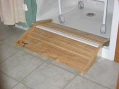 roll in shower stall | The lip of a step-in stall is converted into a roll-in shower with a ...
