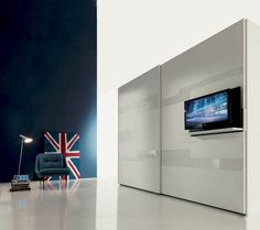 Contemporary sliding door wardrobe with TV screen integrated - GHOST - Fimar Srl - Videos