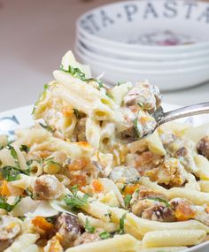 This hearty pasta dish combines the flavors of roasted butternut squash, sweet Italian chicken sausage and fresh basil finished in a Parmesan cream sauce.