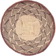 Intricately woven, high contrast patterns are the hallmark of these baskets from the valley Tonga people of Zimbabwe.