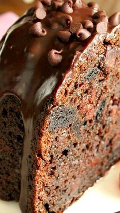 Chocolate Fudge Oreo Bundt Recipe ~ This cake was over the top, there's the chocolate cake, chocolate pudding, chocolate syrup, chocolate chips and chocolate cookies. Then topped with silky ganache and even more chocolate chips.