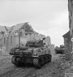 A Sherman and Churchill tank advance through Overloon during the attack by Division on an enemy pocket near the town, 14 October Normandy Ww2, Operation Market Garden, D Day Landings, War Machine, Machine Guns, Ww2 Pictures, Sherman Tank, Ww2 Tanks, British Army