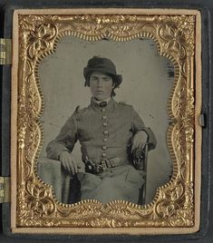 A sixth-plate ambrotype, hand-colored of an unidentified soldier in Confederate cavalry uniform and snake belt buckle with two revolvers. The Liljenquist Family Collection; Library of Congress. American Civil War, American History, American Soldiers, Southern Heritage, Confederate States Of America, War Image, Civil War Photos, Humor, Daguerreotype