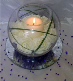 Foam Rose, Onion Grass, Candle Wedding Table Centerpiece  Nice idea, maybe with different (or no) flowers