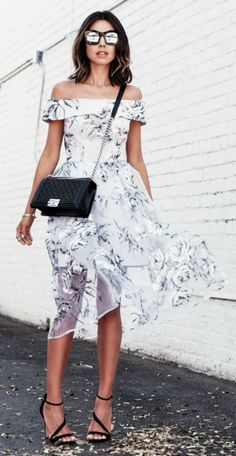 Both the big black florals on a white canvas and the off the shoulder trend is on display here. Via Annabelle Fleur  Dress: Asos, ASOS, Sunglasses. Illesteva, Bag, Chanel, Shoes: Carvela. Off The Shoulder Dress Outfit