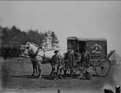 U.S. Mail wagon, 2nd Corps, Army of the Potomac, ca. 1864.  The clover painted on the side of the wagon was the insignia of the 2nd Corps: red for the 1st Division, white for the 2nd Division, and blue for the 3rd Division.