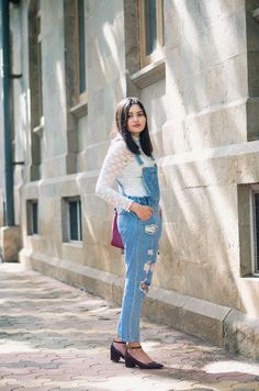 Ripped denim overalls with white long sleeve top and black high heels- Wildfire charm