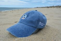 High-quality Cape Cod Life caps are a washed navy color and are embroidered with our iconic lighthouse and brand philosophy. The caps come one-size-fits-all and can be adjusted easily with a timeless brass buckle.