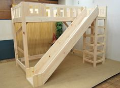 Wooden Loft Bed with Slide... Perfect way to start your day!