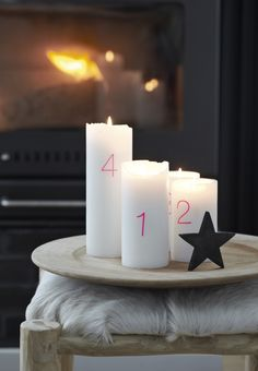 Simple and nordic advent decoration with candles for Christmas.