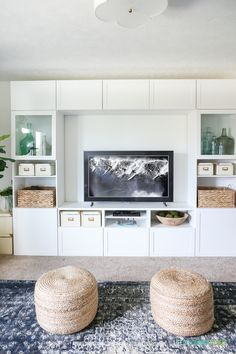 Completely blown away by this TV that looks like art (The Frame from Samsung). Also loving this craft room / TV room painted in Benjamin Moore Simply White. The IKEA BESTA stores fabric and other crafts, and the navy blue rug, fig tree and sisal poufs add