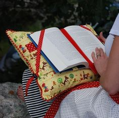 The Reading Pillow is perfect for encouraging a child to read or providing relief for grandma's hands. This pattern features straps to hold the book securely on the pillow and page holders to keep the book open, so your hands are completely free while reading. Also included are