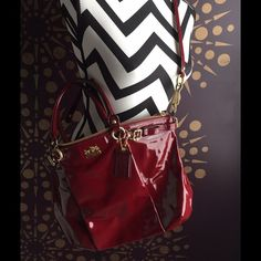 Coach Patent Leather Purse Cranberry & Gold Gorgeous cranberry red patent leather with gold hardware and interior.  12x15 with exterior zip pocket for keys and 3 interior pockets.  Small stains on side yet barely noticeable with all the shine! Coach Bags Satchels