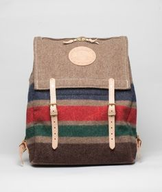 954b0feb94a29 Practical backpack from Yuketen made in a striped wool outer with a tough  canvas inner and natural leather straps. Features a zip close top  compartment and ...