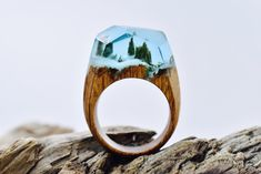 Waterfall Ring designed and made by Secret Wood. Fresh wood, jewelry resin and beeswax.
