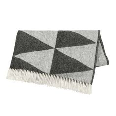 Wrap yourself in the warm and cozy Rime throw from the Swedish brand Nordic Nest. The throw is made of pure lambs wool with a pattern inspired by rime with its beautiful ice crystals and unique formations but is also a flirt with the current harlequin trend. The throw looks great in the sofa and will definitely keep you warm on chilly evenings! Choose from different colors.