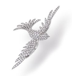 A diamond brooch designed as a pavé-set diamond swallow, enhanced by baguette-cut diamonds; estimated total diamond weight: 7.50 carats; mounted in eighteen karat white gold; length: 3 1/2in.