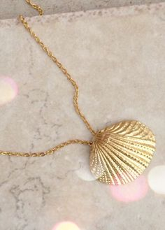 A personal favorite from my Etsy shop https://www.etsy.com/listing/236298365/gold-shell-necklace-gold-necklace